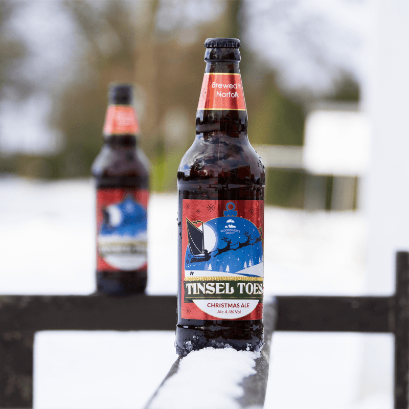 Tinsel Toes in the snow | Woodforde's Brewery